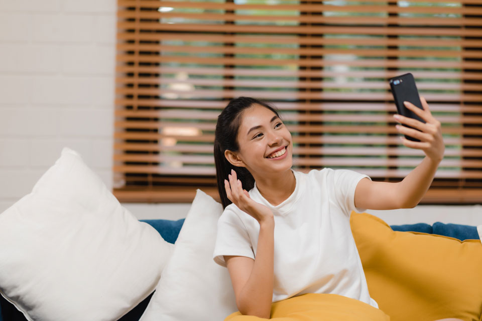 asian-woman-smartphone-video-conference