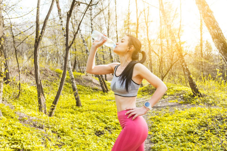 woman-drinking-water-nature